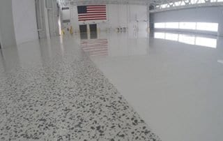 Airplane Hangar Floor Coating Application - Vinyl Chip